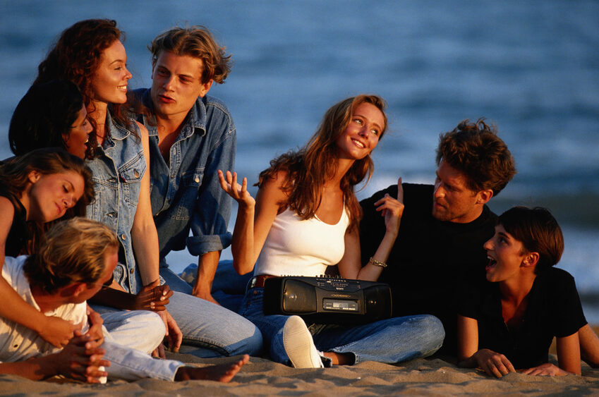 Young people on Beach Laughing